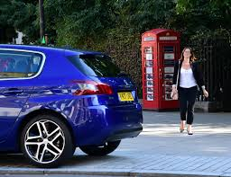 nearly new peugeot world u0027s smallest car dealership is a peugeot london phone box