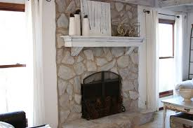 pretty rock fireplace on interior with fireplace hearth stone