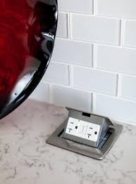 kitchen design idea install a pop up outlet directly into your