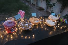 how to host an outdoor movie night in your own backyard local