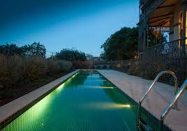 elegant long backyard swimming pool design ideas with chrome