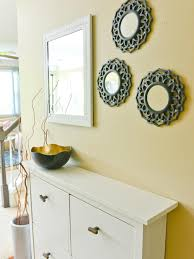 Mirror Wall Decor by Wall Decor Tricks Try Decorating In Threes Diy Network Blog