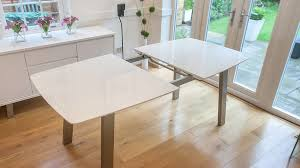 contemporary dining tables extendable assi white gloss extending dining table brushed metal white table