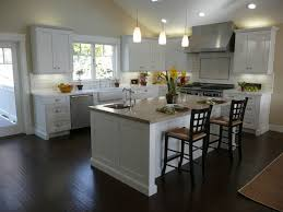 sleek kitchen with white cabinet also dark brown laminate floor