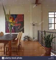 vase of tall flowers on table in modern dining room with wooden