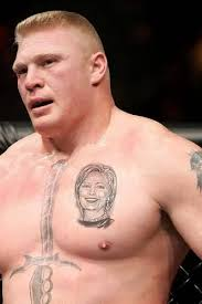 cool big brock lesnar show sword and smiling lady face tattoo on