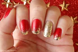 classic red and gold christmas manicure adjusting beauty