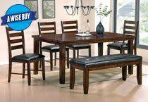 rent to own dining room tables the san paulo dining group by steve silver features a medium wood