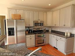 Traditional Kitchen With Complex Granite Counters Lshaped - Baltic brown backsplash