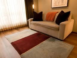 Throw Rug On Top Of Carpet 6 Great Ways To Use Throws In A Living Room Hgtv