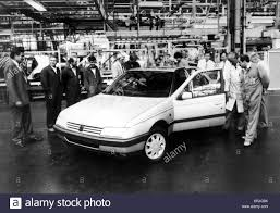 the peugeot family a new peugeot rolls off the production line at the peugeot factory