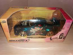 nissan 350z insurance for 17 year old cool great jada toys option d blue nissan 350z 1 24 scale diecast
