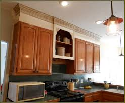 white upper kitchen cabinets black lower kitchen cabinets
