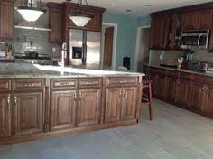 Dark Walnut Kitchen Cabinets by Ice Box Latches Natural Walnut Cabinets Kitchen Cabinet Ideas