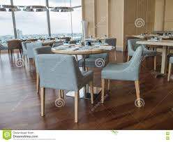 modern restaurant of hotel with wooden furniture stock photo