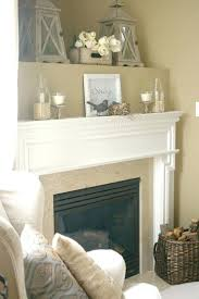 candles in tea cups fireplace and completed mantel decorating