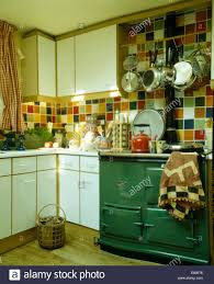 Kitchen Green Kitchen Colors Stock Green Aga Oven In Kitchen With Multi Coloured Wall Tiles Stock