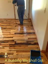 How To Laminate Flooring A Building We Shall Go The Art Of Pallet Wood Flooring