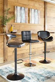 Juararo Bedroom Furniture Dimensions In Mass Brown And Black Tall Upholstered Swivel Barstool From Ashley