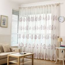 quality linen curtains panels in white color embroidered with leaf