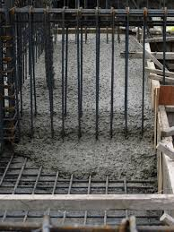 file concrete slowly flowing through the rebar beam cage jpg