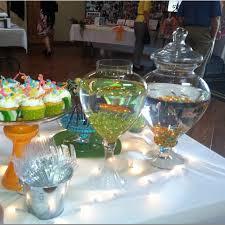 graduation table decoration idea goldfish as center pieces party