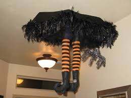 the funky letter boutique halloween witch falling from the