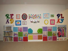 use two 5 shelf ikea bookcases turned on their sides add baskets