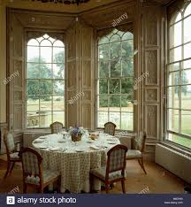 Gothic Dining Room by Upholstered Chairs And Table Set For Lunch In Front Of Tall Gothic