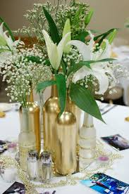 gold centerpieces gold centerpieces wine and bottles cakes centerpieces