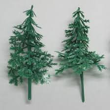 set of 4 small plastic evergreen fir trees