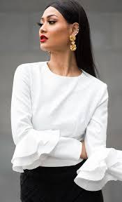 white blouses gold floral earrings white ruffle sleeve blouse black skirt