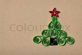 handmade christmas tree cut out from paper quilling stock photo