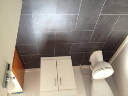 Kitchen Liquidators Grey Ceramic Flooring Tile With White Vanity Also Toilet Bathtub