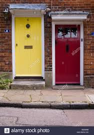 two painted front doors one in yellow and one in red in a row of