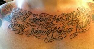 an oscar wilde quote and a tattoo on my chesticle the