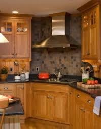 kitchen backsplash with oak cabinets contrast of charcoal counters oak cabinets slate backsplash look