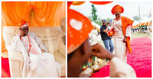 orange and champagne traditional nigerian wedding aisle perfect
