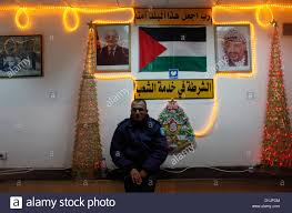 Christmas Decoration Outside Church by A Palestinian Policeman With Christmas Decorations In A Police