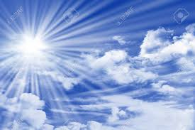 blue sky with clouds sun and sun rays stock photo picture and