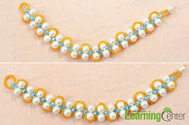 double pearl bracelet images How to make a double strand white pearl bracelet with orange seed jpg