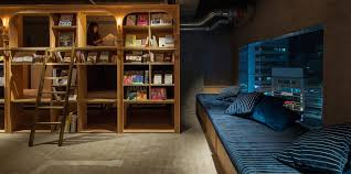 bookstore themed tokyo hotel has 1 700 books and sleeping shelves