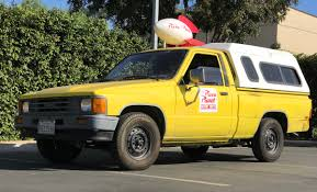 yellow toyota truck the pizza planet truck visited us and it was the best day of our