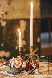 Gold Table Centerpieces by Table Decor Of Gold Candlesticks And Glass Boxes With Pink Roses