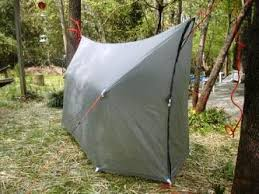 with the right tarp your hammock can become a wind and rain