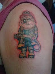 red ink taz tattoo on left shoulder for men
