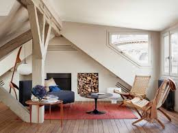 relaxing attic living room with cream colored walls and modern