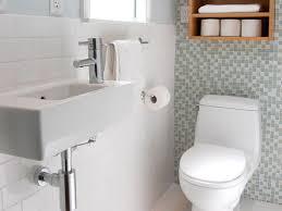 bathroom modern toilet plus freestanding sink vanity and towel