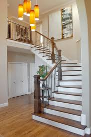 Wrought Iron And Wood Banisters Wrought Iron Shelf With Tiered Chandelier Stone Tread Dark Wood
