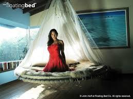 dream bed hammocks meet round mattresses in this hanging design